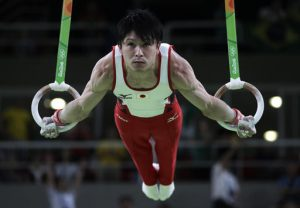 Japan's Kohei Uchimura performs on the rings during the artistic gymnastics men's qualification at the 2016 Summer Olympics in Rio de Janeiro, Brazil, Saturday, Aug. 6, 2016. (AP Photo/Julio Cortez)